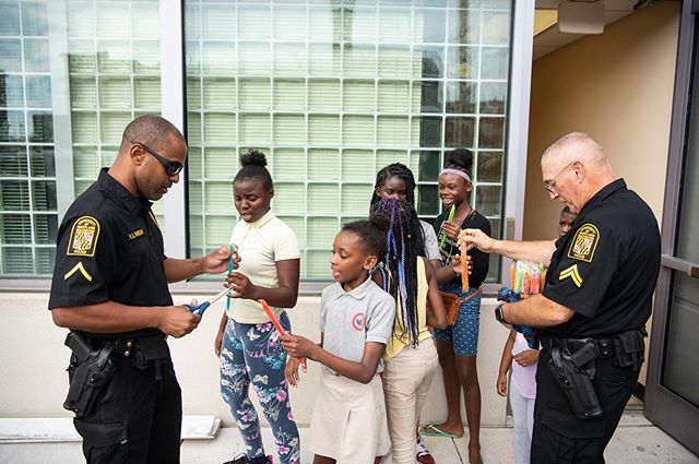 On a record hot 98 degree day in Baltimore on Oct. 2, the @policeumb Police Activities/Athletic League (PAL) Program put their own spin on #CoffeeWithACop, a national event where officers and members of the communities they serve sit down over a cup of coffee to discuss issues and learn more about each other. UMB police officers and kids in the UMB PAL Program got together for a popsicle party as their own version of Coffee With a Cop. Pfc. Kelli Blackwell and @officerlexi, UMB's comfort canine officer were there to join in the fun! UMB's PAL chapter is one of the few in #Baltimore City and one of two on a college campus. #NPALCoffeeNCopDay #UMBPDOutreach